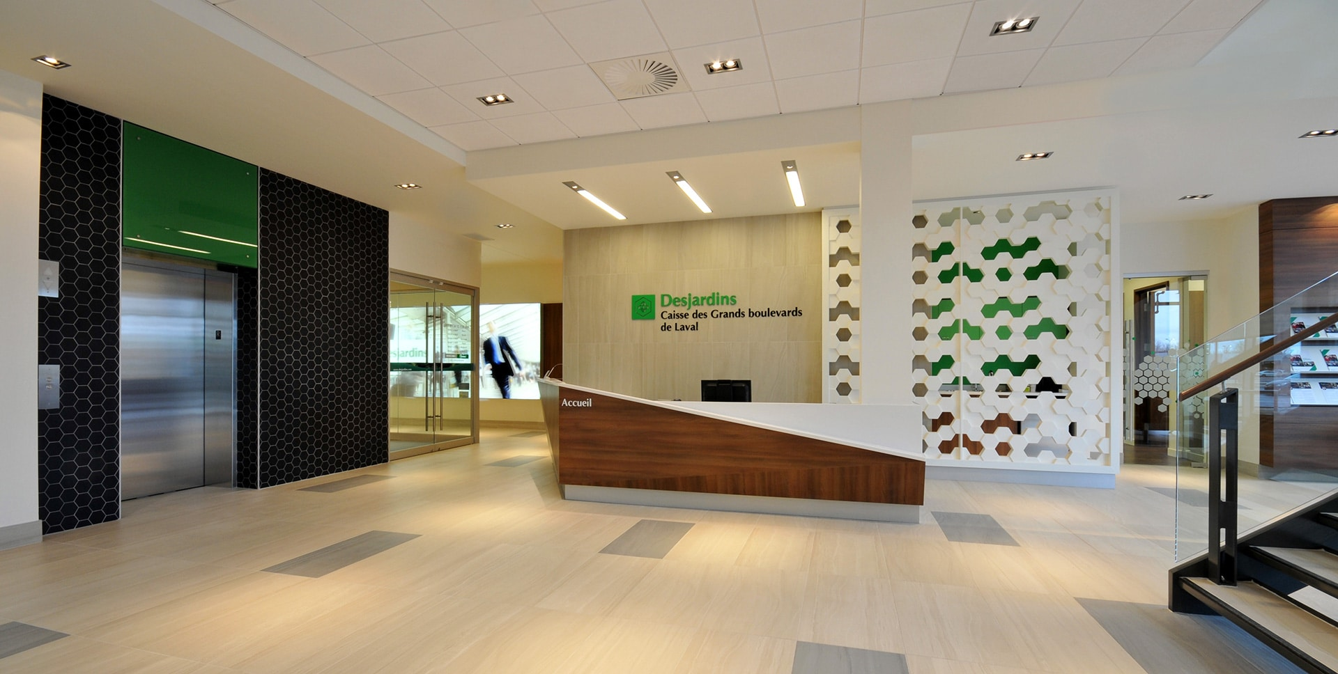 Reception and elevator at Desjardins in Laval designed by VAD