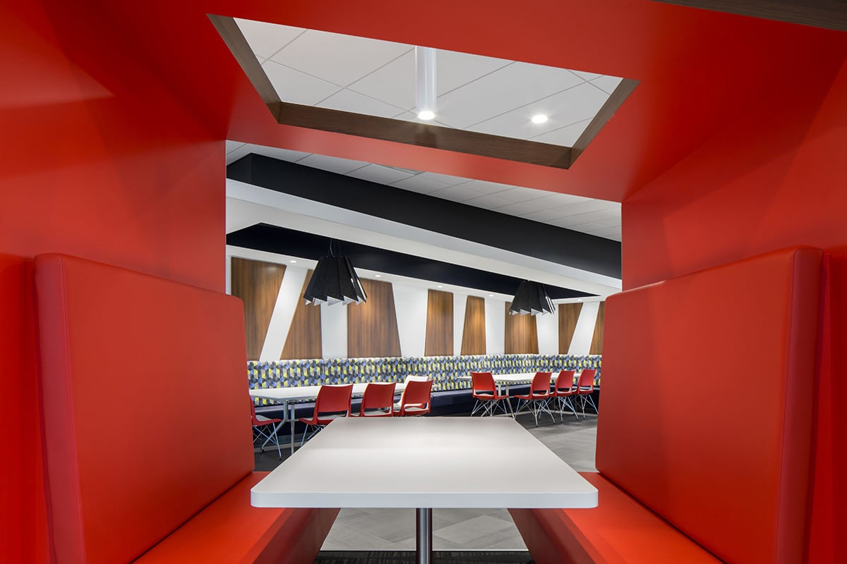 Red booth at National Bank's Distrcit in Montreal designed by VAD