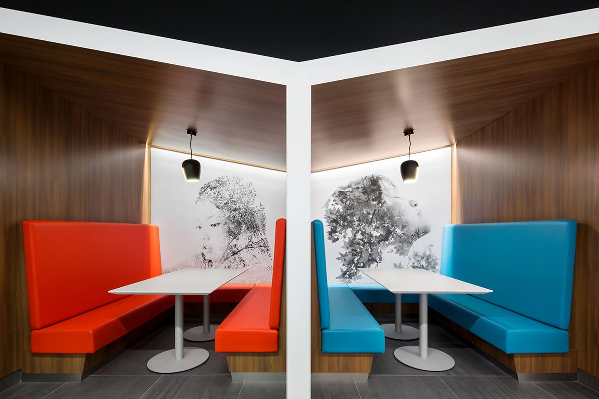 Red and blue booth at National Bank's Distrcit in Montreal designed by VAD