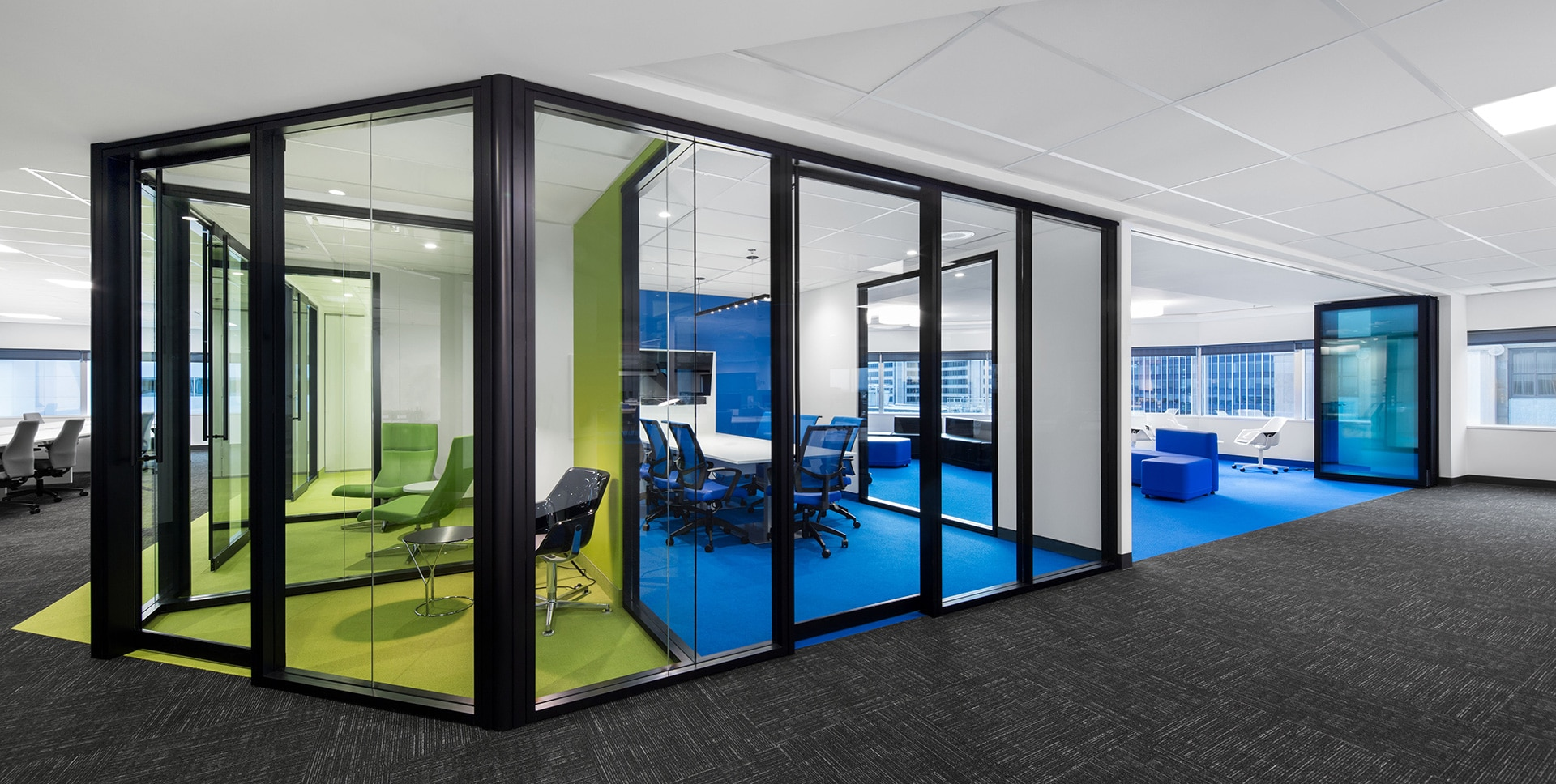 Green and blue meeting rooms at National Bank headquarters in Montreal designed by VAD