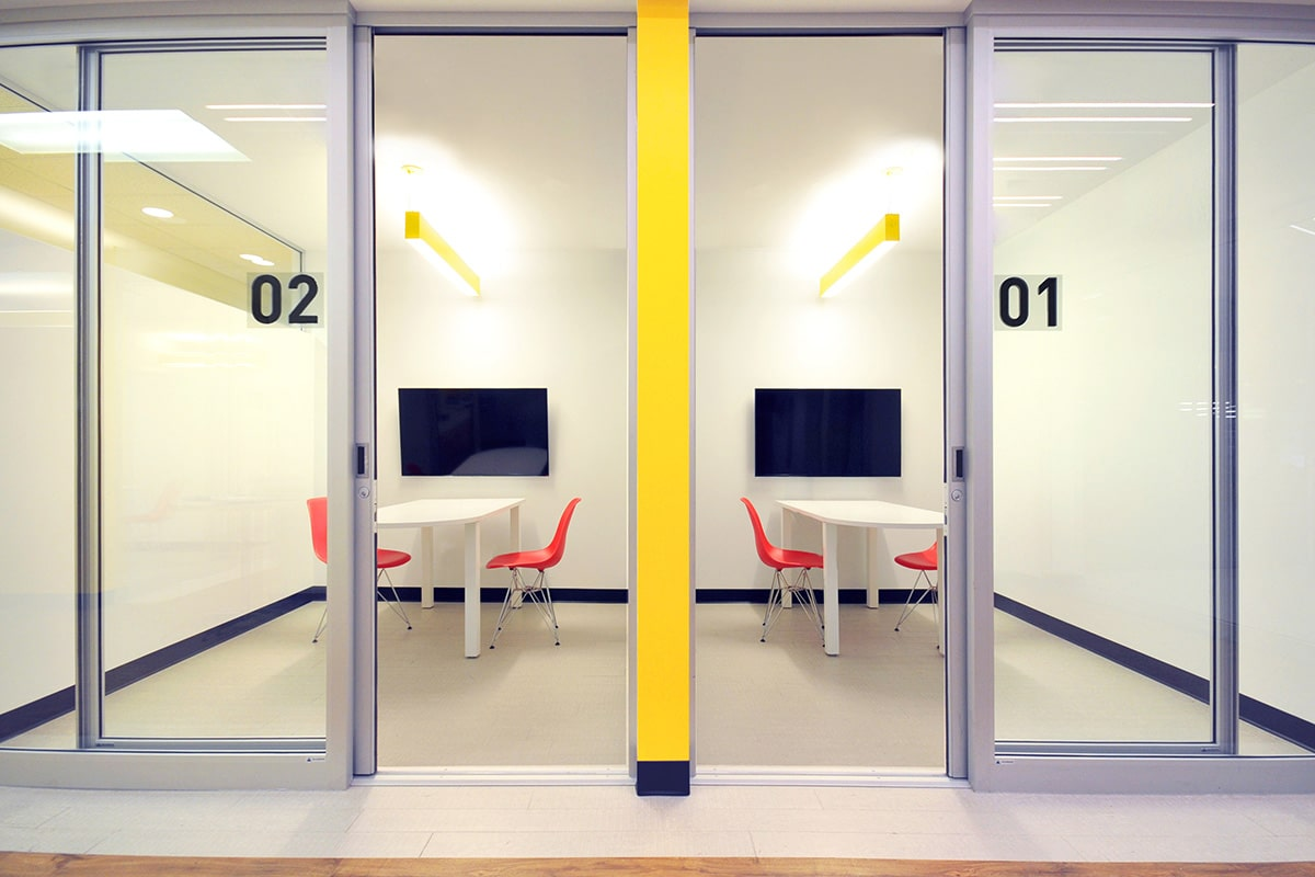 Meeting room yellow accents LaSalle College designed by VAD