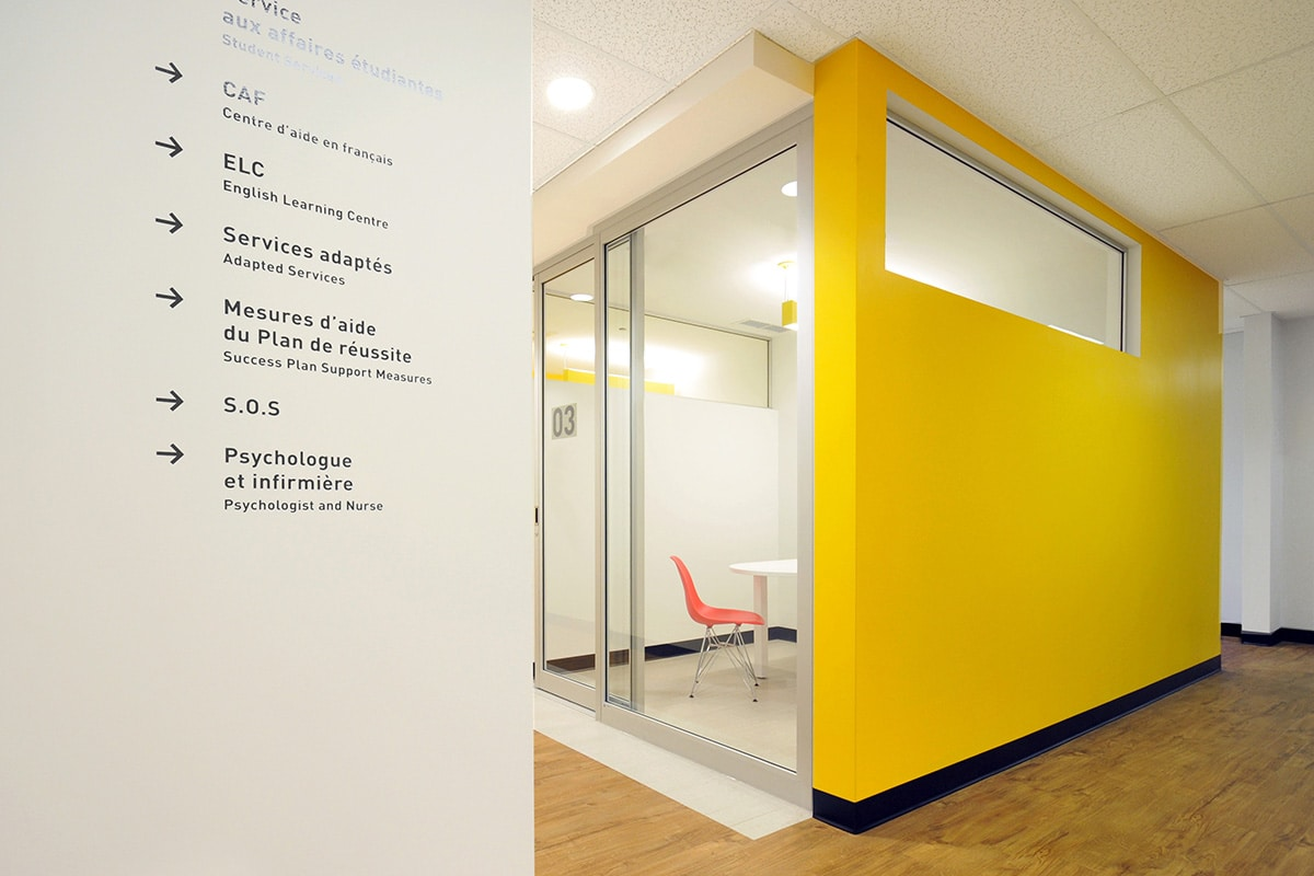 Yellow wall and interior signage at LaSalle College designed by VAD
