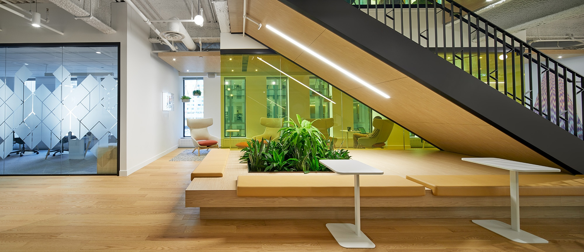 Staircase and plants at the Montreal FinTech Station design by VAD